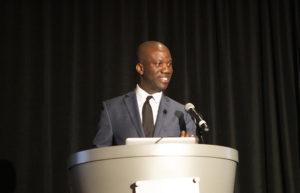 photo of speaker at a podium