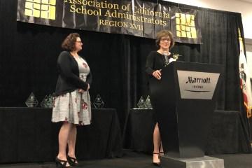 Superintendent Joanne Culverhouse accepts an award
