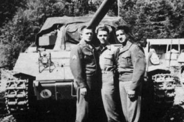 historical photo of world war 2 soldiers in front of a tank.