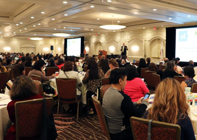 Large audience in a hotel ballroom