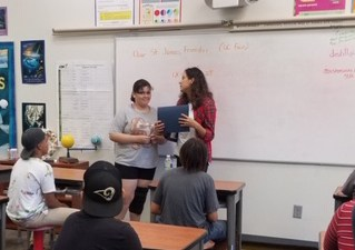 student receives award in classroom