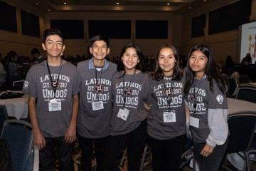 Five students in Latino Unidos T-shirts