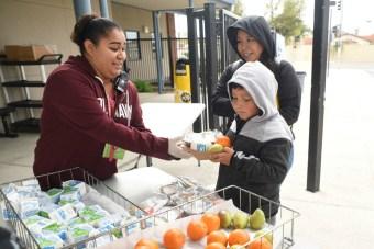 School staff serving meals