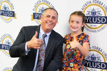 Superintendent Plutko and student