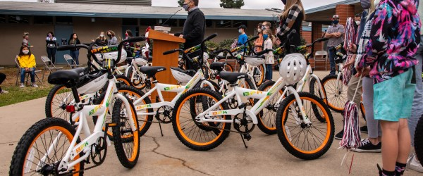 Bikes and students at an assembly