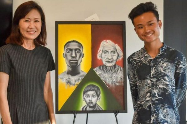 "Raymond Tran-Nguyen First Place Painting, ""Unity"" (L to R: Congresswoman Michelle Steel (CA-48), CMHS Student Raymond Tran-Nguyen)"