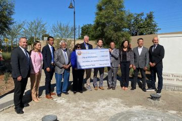 Local dignitaries with over-sized check