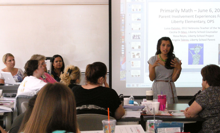 Luisa Palomo (standing) talks to Primarily Math Cohort 3 LPS on June 6.