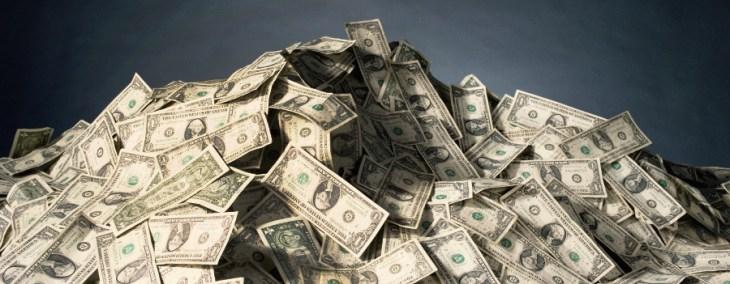 Dollar Bills Pile - Image Copyright NewsRoomInk.Com