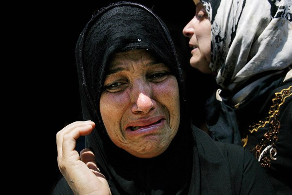 Women grieve during a mass funeral in Tyre, Lebanon, on July 29, 2006, after weeks of Israeli airstrikes. | Source: AFP/Nicolas Asfouri