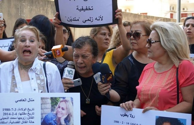 Activists, women and human rights groups stage a protest outside Beirut's Justice Palace in Adlieh, Tuesday, Aug. 16, 2016. (The Daily Star/KAFA, HO)