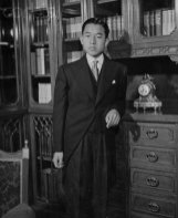 10 Nov 1952, Tokyo, Japan --- Original caption: Heir to Chrysanthemum Throne. Tokyo, Japan: In morning clothes, Prince Akihito Tsugu-No-Miya, 18-year-old son of Emperor Hirohito of Japan, who today was formally proclaimed heir-apparent to the Chrysanthemum Throne of Nippon in a ritual going back for some 1,200 years. This photo was made as the crown prince prepared for the ceremony of transition into manhood. November 10, 1952. --- Image by © Bettmann/CORBIS