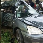 Speeding car wraps around tree leaving three persons injured