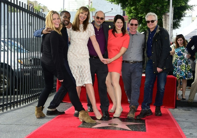 Actress Allison Janney poses with various cast members and friends at her Hollywood Walk of Fame star on October 17, 2016 ©Frederic J. Brown (AFP)