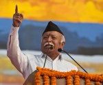 """FILE - In this Jan. 21, 2018 file photo, Mohan Bhagwat, chief of the Rashtriya Swayamsevak Sangh, a hardline Hindu group that created the Bharatiya Janata Party as its political arm, addresses a public rally in Gauhati, India. India's ruling party and the main opposition are both supporting a protest to keep females of menstruating age from entering one of the world's largest Hindu pilgrimage sites, in what some political observers say is a bid to shore up votes ahead of next year's general election. Bhagwat has sided with the protesters, saying the """"faith of millions of devotees was not taken into account,"""" during a Hindu festival in New Delhi on Thursday, Oct. 18, referring to a Supreme Court ruling that opened  the temple up to women of all ages for the first time in centuries. (AP Photo/Anupam Nath, File)"""