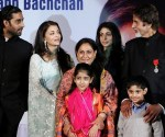 (FILES) In this file photo taken,  27 January 2007, Indian film actor Amitabh Bachchan (R) poses with his wife Jaya Bachchan (C), son Abhishek Bachchan (L), soon to be daughter-in-law Aishwarya Rai (2-L) and daughter Shweta Nanda during a function at the French Embassy in New Delhi, after recieving  the Legion d'Honneur. As stated in a report released, 24 March 2007,  Bollywood superstar Amitabh Bachchan has denied reports that his family performed Hindu religious ceremonies to lift a curse from Bollywood actress Aishwarya Rai who is engaged to marry his son. AFP PHOTO/Manan VATSYAYANA (Photo credit should read MANAN VATSYAYANA/AFP/Getty Images)