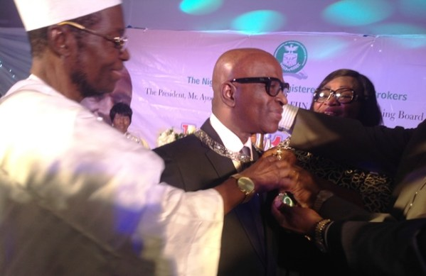 Former Presidents of the Nigerian Council Of Registered Insurance Brokers (NCRIB) decorating Mr. Kayode Okunore, in-coming President of the Council with the staff of office on Thursday in Lagos