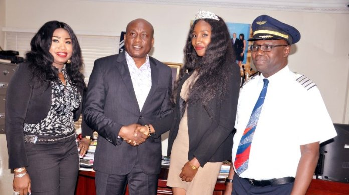 "Air Peace Airline Ambassador, Miss. Nigeria 2015, Leesi P. Peter-Vigboro, (3rd left) receiving copy of a book ""None Violent"" from Chairman/Chief Executive Officer, Air Peace Airline, Barr. Allen Onyema (2nd left), Chief Operating Officer/Managing Director, Miss. Oluwatoyin Olajide (left) and Director of Flight Operations, Capt. Wellington Eyimina during Miss. Nigeria's courtesy visit to Air Peace Airline"