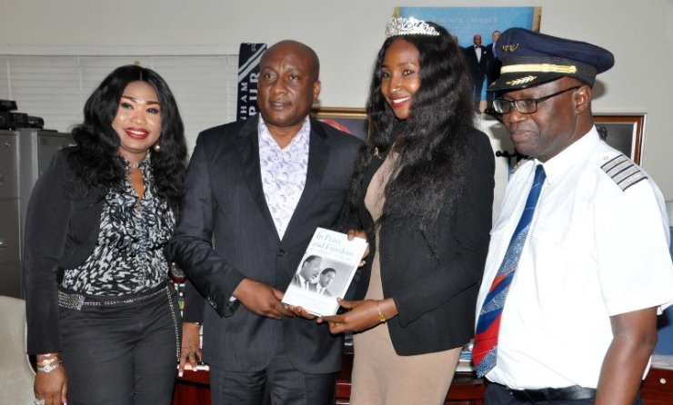 """Air Peace Airline Ambassador, Miss. Nigeria 2015, Leesi P. Peter-Vigboro, (3rd left) receiving copy of a book """"None Violent"""" from Chairman/Chief Executive Officer, Air Peace Airline, Barr. Allen Onyema (2nd left), Chief Operating Officer/Managing Director, Miss. Oluwatoyin Olajide (left) and Director of Flight Operations, Capt. Wellington Eyimina during Miss. Nigeria's courtesy visit to Air Peace Airline"""