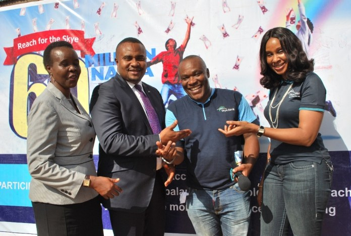 "L-R: Assistant Director, National Lottery Regulatory Commission, Fisinba Idasefiema, Regional Director Commercial Abuja & North Central , Skye Bank Plc, Osazuwa Igbinoba,  Nollywood Actor and Celebrity Host, Kingsley Ogbonna , alias  Dauda  and Head, Retail Banking, Skye Bank Plc,  Nkolika Okoli, at the  Bank's ""Reach For The Skye""  reward draw held in Kubwa  Main Market, Abuja…..recently"