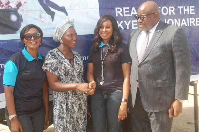 "L-R: Area Manager, Greater Lagos 2, Skye Bank Plc., Adejumoke Odutola, Winner of one of the instant giveaway prizes, Muibat Adelana, Head, Retail Banking, Skye Bank Plc., Nkolika Okoli and Regional Director, Ikeja, Skye Bank Plc., Ndubuisi Osakwe at the Bank's ""Reach For The Skye"" reward draw held in Better Life Main Market, Ikorodu area of Lagos on Thursday"
