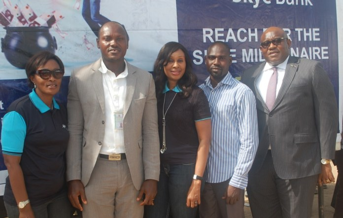 "L-R: Area Manager, Greater Lagos 2, Skye Bank Plc., Adejumoke Odutola, Assistant Manager, National Lottery Regulatory Commission, Lagos 2, Horace Abolo, Head, Retail Banking, Skye Bank Plc., Nkolika Okoli, Administration Manager , National Lottery Regulatory Commission, Lagos 2, Adebajo Adebola and Regional Director, Ikeja, Skye Bank Plc., Ndubuisi Osakwe at the Bank's ""Reach For The Skye"" reward draw held in Better Life Main Market, Ikorodu area of Lagos on Thursday"