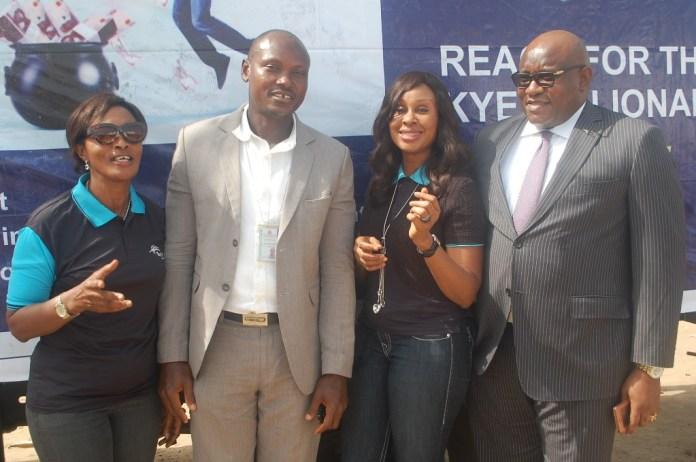 "L-R: Area Manager, Greater Lagos 2, Skye Bank Plc., Adejumoke Odutola, Assistant Manager, National Lottery Regulatory Commission, Lagos 2, Horace Abolo, Head, Retail Banking, Skye Bank Plc., Nkolika Okoli and Regional Director, Ikeja, Skye Bank Plc., Ndubuisi Osakwe at the Bank's ""Reach For The Skye"" reward draw held in Better Life Main Market , Ikorodu area of Lagos on Thursday"
