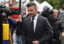 Beckham gets 6-month driving ban for using phone