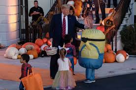Trumps Dump Candy Bars on Minion's Head for Trick or Treat