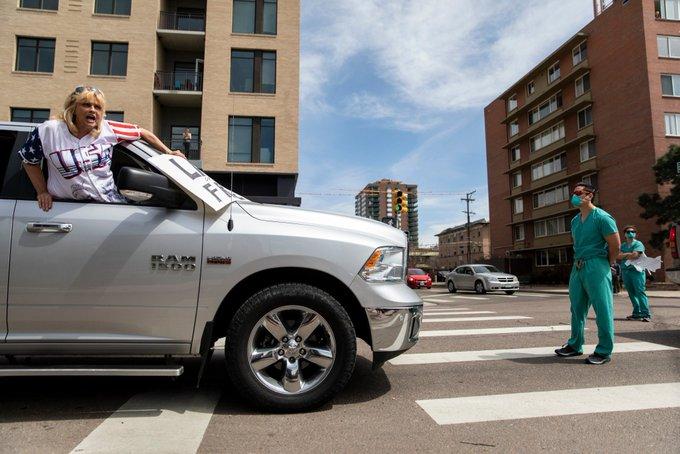 Nurses block COVIDIOT protesters in Denver