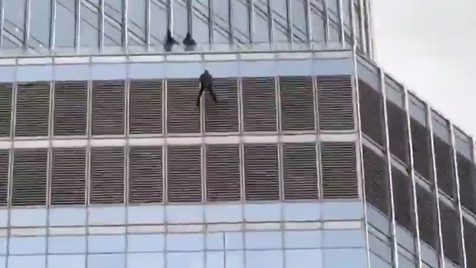 Some guy is dangling from Trump Tower in Chicago, threatening to kill himself, and demanding to speak to Trump