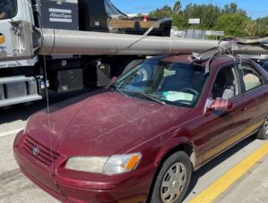 Florida Man Straps Utility Pole to Roof of Car, Gets Charged with Grand Theft
