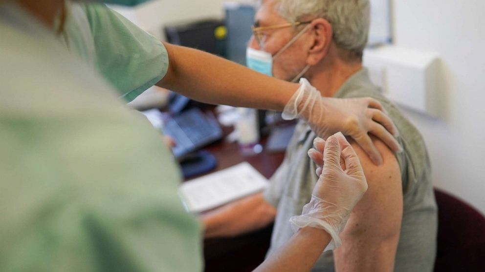 UK's new COVID-19 vaccination plan prioritizes 1st doses. What does that mean?