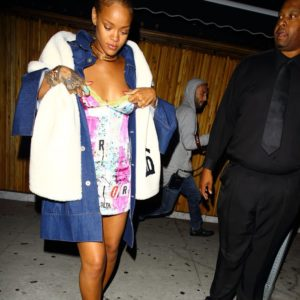 rihanna-readjusts-her-dress-on-a-night-out-1465897155-custom-0