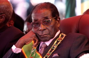 Zimbabwe's President Robert Mugabe looks on during a rally marking Zimbabwe's 32nd independence anniversary celebrations in Harare April 18, 2012.REUTERS/Stringer (ZIMBABWE - Tags: POLITICS ANNIVERSARY) - RTR30W6H