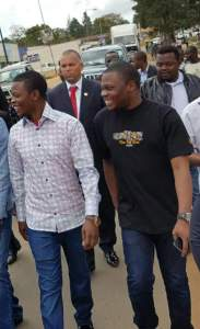Major One walking in the streets of Mzuzu with his brother Otis Bushiri.
