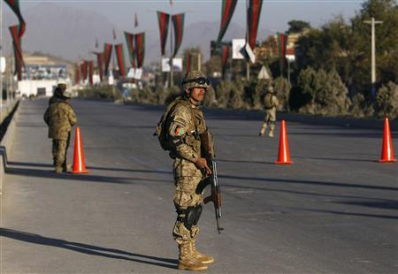 Afghan policemen keep watch at the area where the Loya Jirga will take place later this week, in Kabul