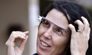 Cecilia Abadie wears her Google Glass as she talks with her attorney outside of traffic court Tuesday, Dec. 3, 2013, in San Diego. When Abadie was pulled over on suspicion of speeding in October, the officer saw she was wearing Google Glass and tacked on a citation usually given to drivers who may be distracted by a video or TV screen. She pleaded not guilty to both charges on Tuesday. (AP Photo/Lenny Ignelzi) Photograph: Lenny Ignelzi/AP