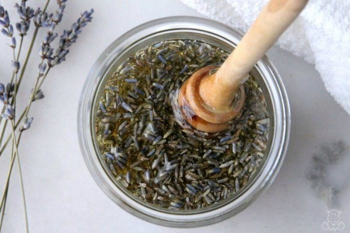 Jar of honey infused with lavender buds