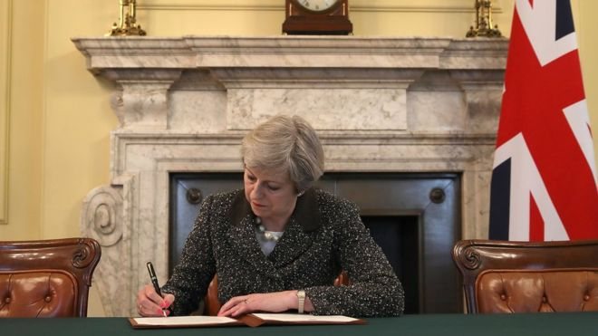 UK PM signs letter that will trigger Brexit