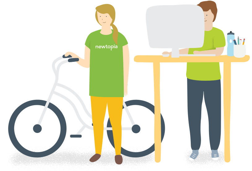 Women with bike and man standing at desk using computer