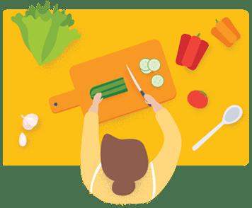 Woman cutting healthy foods on a chopping board
