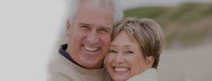 Senior couple on beach close up