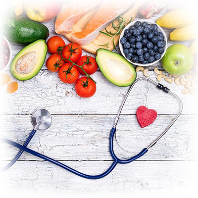stethoscope and heart and veggies