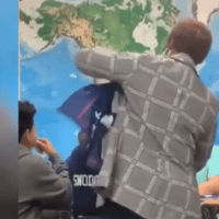 Virginia Teacher Wraps Trump Flag Around Student's Neck
