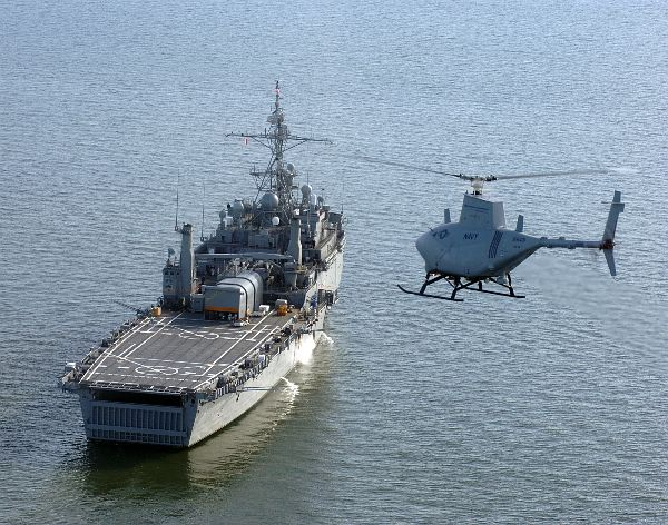 A RQ-8A Fire Scout UAV prepares for landing aboard USS Nashville.