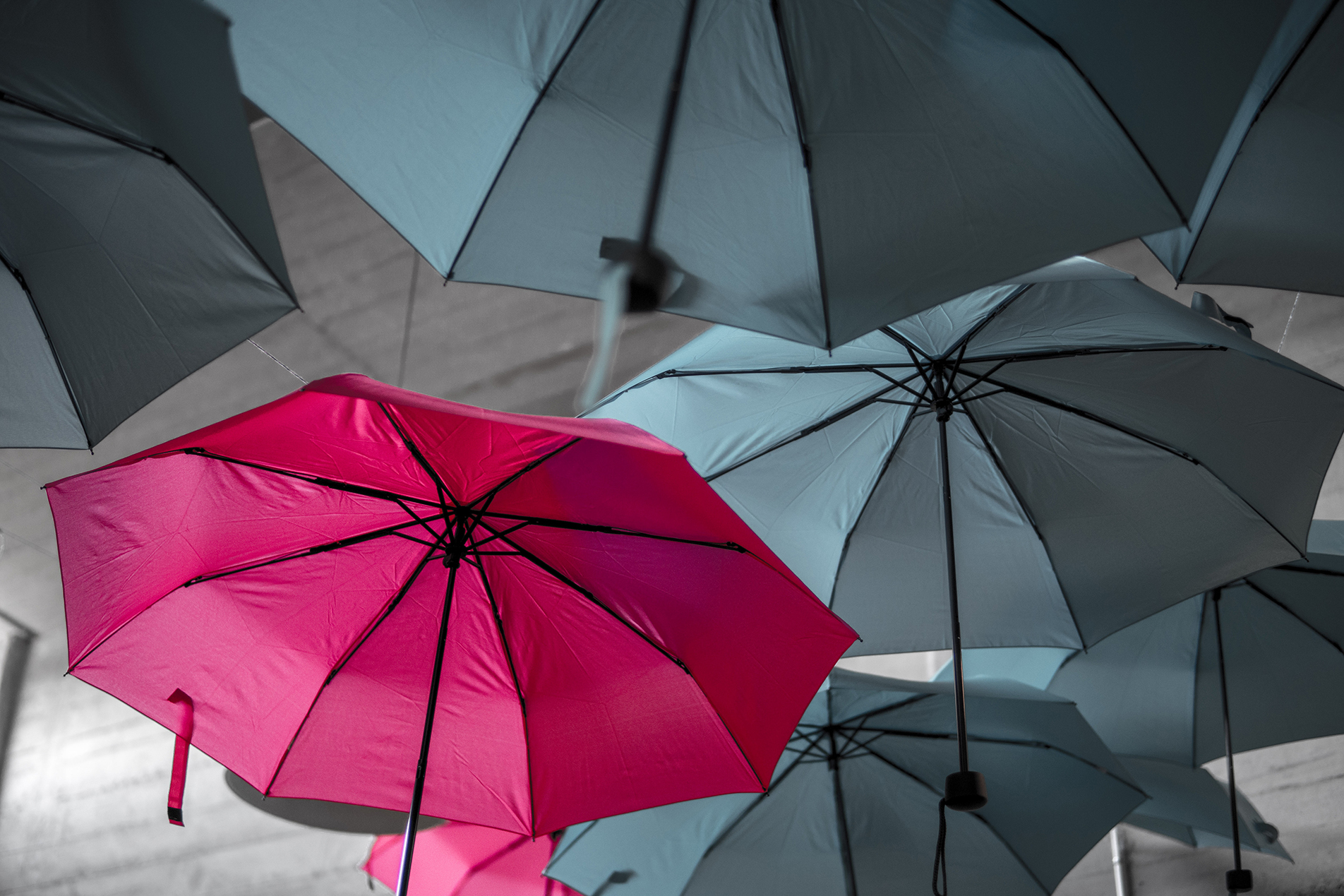engaging your audience - one red umbrella in the midst of all grey umbrellas - stand out!