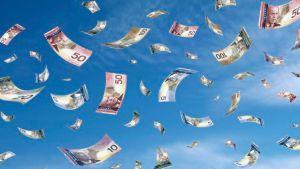 Money Flying Away in Land Swap