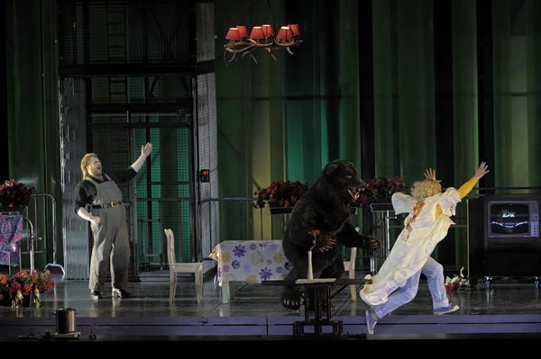 The Bear chases Mime (Wolfgang Ablinger-Sperrhacke) as Siegfried (Torsten Kerl) laughs.