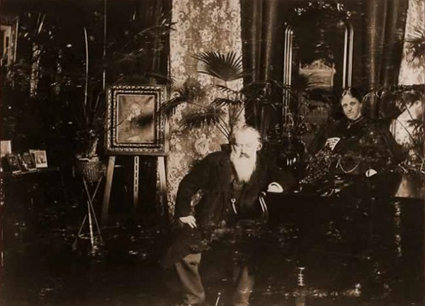 Johannes Brahms sitting at the piano in the music room of his friends, Richard and Maria Fellinger